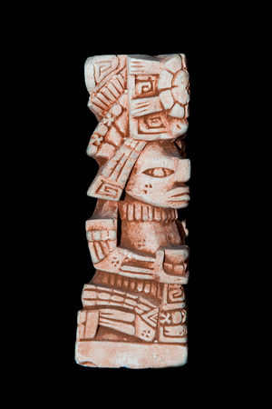Mayan statue isolated against a black background Reklamní fotografie