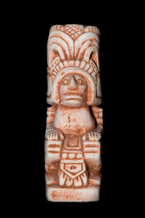 Mayan statue isolated against a black background Stockfoto