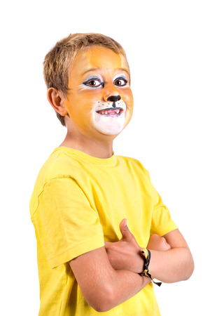 Boy with animal face-paint isolated in white Foto de archivo