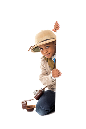 Young boy playing Safari isolated in white