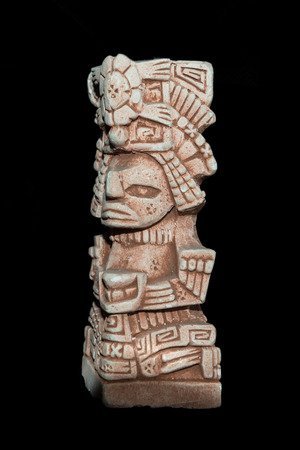 Mayan statue isolated against a black background Banco de Imagens