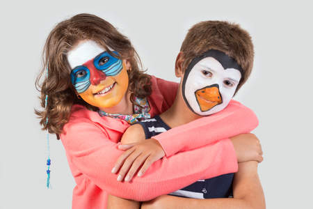 Children's couple with animal face-paint isolated in white Archivio Fotografico - 113700642