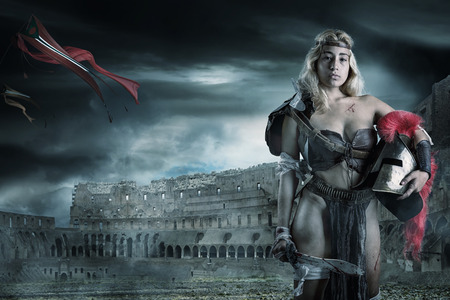 Ancient woman warrior or Gladiator in the arena 免版税图像
