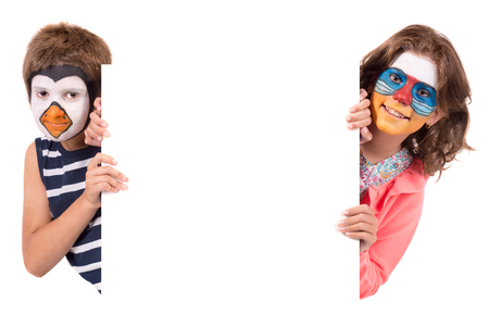 Children's couple with animal face-paint isolated in white Archivio Fotografico - 117135867