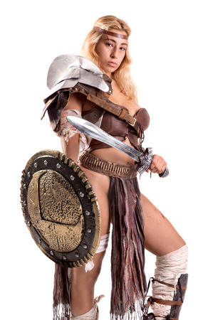 Ancient woman warrior or Gladiator posing with sword and shield, isolated in white Stock fotó