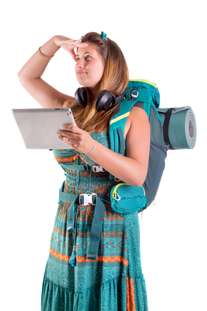 Hiker girl with tabletk isolated in white, trekking and travel lifestyle concept