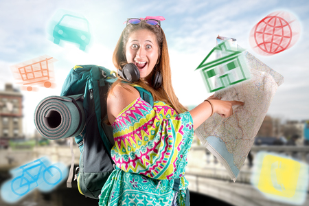 Happy hiker girl with backpack and map, trekking and travel lifestyle concept