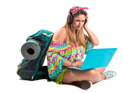 Hiker girl with laptop isolated in white, trekking and travel lifestyle concept