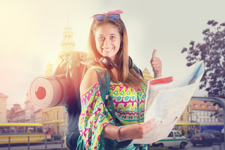 Hiker girl with backpack and map isolated in white, trekking and travel lifestyle concept Stok Fotoğraf