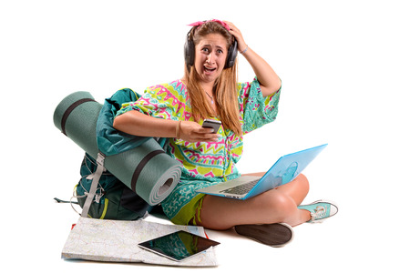 Lost and stressed girl with many devices looking for directions, trekking and travel lifestyle concept