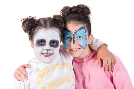 Girls with animal face-paint isolated in white Stockfoto