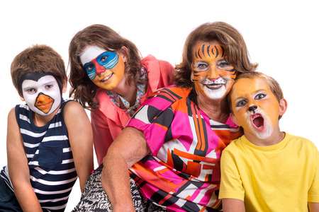 Childrens group and grandmother all with animal face-paint isolated in white
