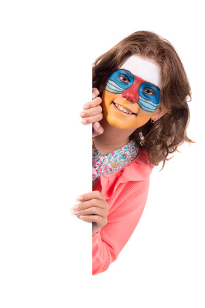 Girl with animal face-paint over a white board, isolated in white Stok Fotoğraf