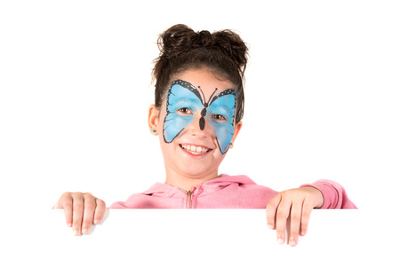 Girl with animal face-paint behind a white board