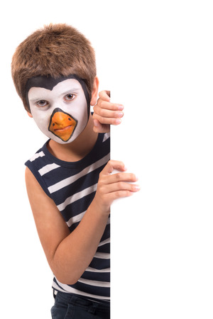 Boy with animal face-paint over a white board isolated in white Stock Photo