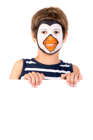 Boy with animal face-paint behind a white board