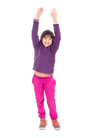Young girl posing with raised arms isolated in white 写真素材