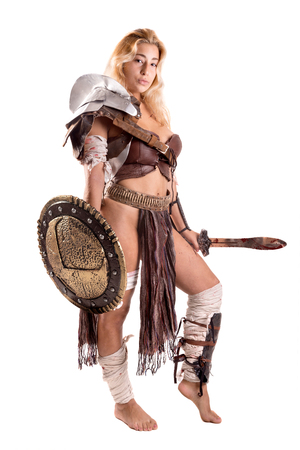 Ancient woman warrior or Gladiator posing with sword and shield, isolated in white Stock Photo