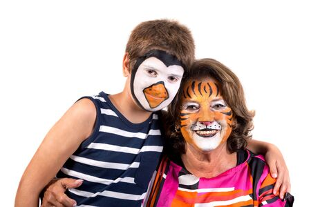 Child and grandmother with animal face-paint isolated in white Stock Photo