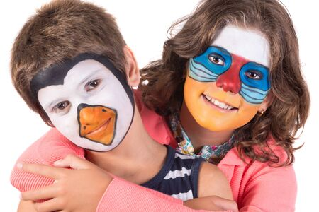 Childrens couple with animal face-paint isolated in white