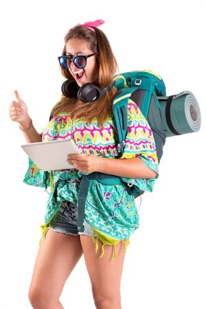 Hiker girl with tablet isolated in white, trekking and travel lifestyle concept
