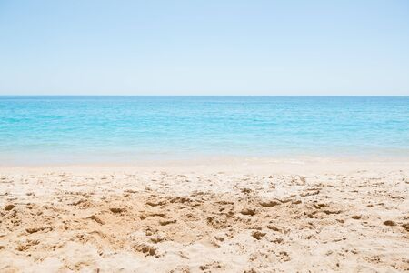 Simple scene of a nice blue sea and sand at the beach.