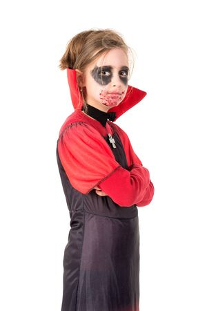 Girl with face-paint and vampire Halloween costume isolated in white