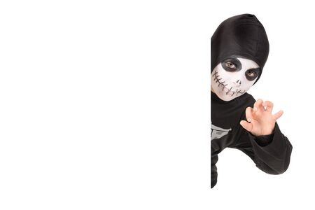Boy with face-paint and skeleton Halloween costume isolated in white