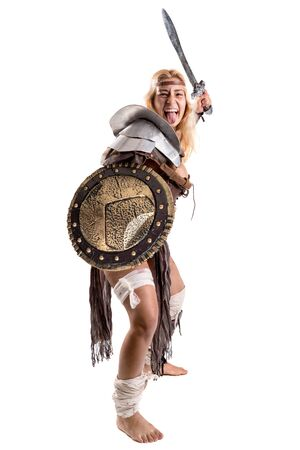 Ancient woman warrior or Gladiator posing with sword and shield, isolated in white Stok Fotoğraf