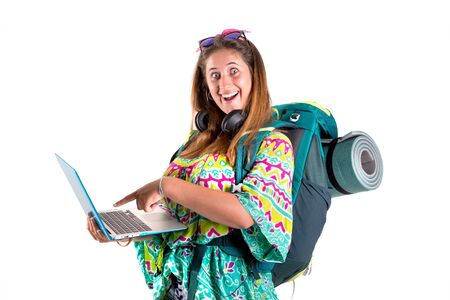 Happy hiker girl with backpack and laptop isolated in white, trekking and travel lifestyle concept Фото со стока