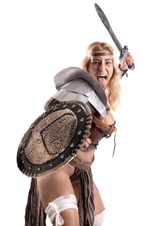 Ancient woman warrior or Gladiator posing with sword and shield, isolated in white