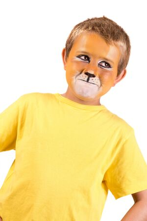 Boy with lion face-paint behind a white board