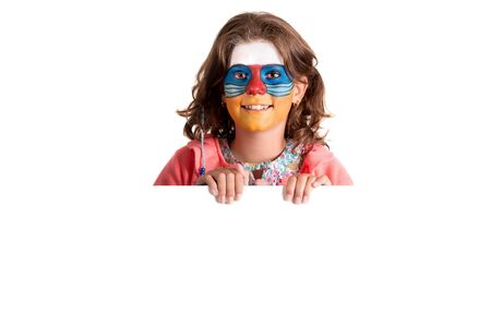 Girl with animal face-paint over a white board, isolated in white Banco de Imagens