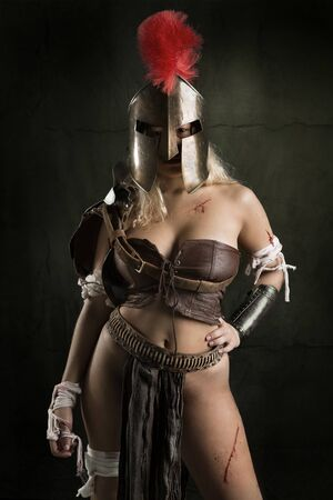 Ancient woman warrior or Gladiator posing in a dark background