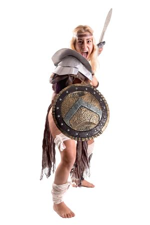 Ancient woman warrior or Gladiator posing with sword and shield, isolated in white Foto de archivo