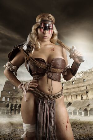 Ancient woman warrior or Gladiator posing in the arena