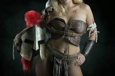 Ancient woman warrior or Gladiator body part, against a dark background Banco de Imagens