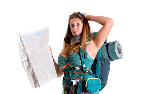 Hiker girl with backpack and map isolated in white, trekking and travel lifestyle concept Banco de Imagens