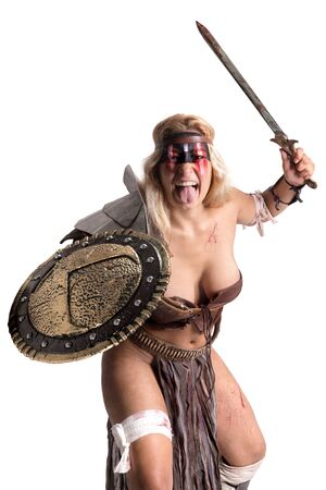 Ancient woman warrior or Gladiator posing with sword and shield, isolated in white Banco de Imagens