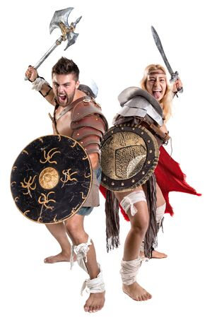 Ancient warrior or Gladiator couple posing in a white background Banco de Imagens