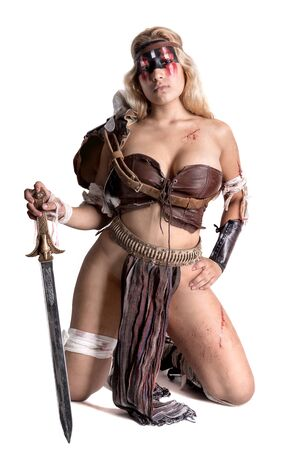 Ancient woman warrior or Gladiator posing with sword, isolated in white