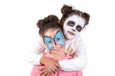 Girls with animal face-paint isolated in white Banco de Imagens