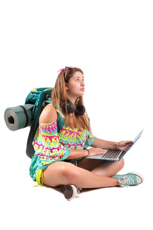 Happy hiker girl with backpack and laptop isolated in white, trekking and travel lifestyle concept Banco de Imagens