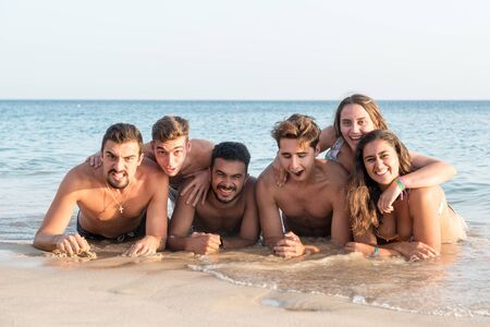 Group of happy young people at the beach