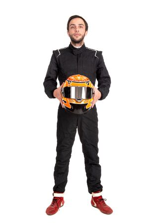 Racing driver in full gear posing isolated in a white background