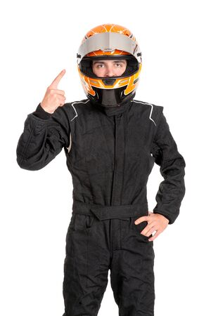 Victorious racing driver posing with helmet isolated in white Imagens