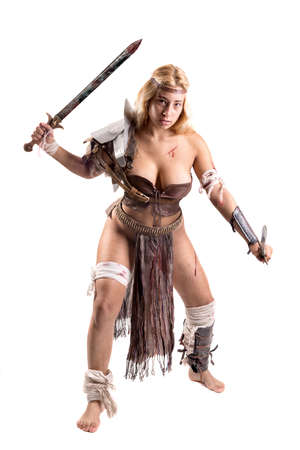Ancient woman warrior or Gladiator posing with swords isolated in white