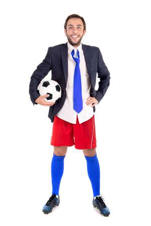 Businessman with soccer ball posing isolated in white Zdjęcie Seryjne