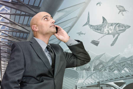 Businessman or stock broker with phone surrounded by business sharks.