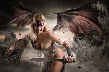Ancient fantasy female warrior with dragon wings in a fantasy landscape Zdjęcie Seryjne